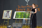 Picture of presenter and paintings at the Eurekahedge Asian Hedge Fund Awards 2006